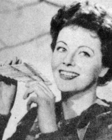 In costume for Peter Pan, Margaret Lockwood plays the panpipes (1950)