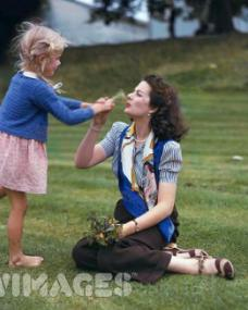 Margaret Lockwood plays outdoors with her 5-year-old daughter Julia Lockwood, who later followed her mother into show business