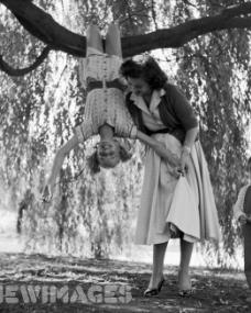 Margaret Lockwood plays with her daughter Julia Lockwood in the garden. Julia is to take the lead in the new six part children's television serial production of 'Heidi'.