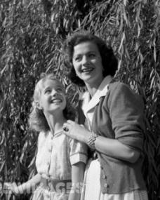 British film actress Margaret Lockwood plays with her daughter Julia Lockwood in the garden. Julia is to take the lead in the new six part children's television serial production of 'Heidi'.
