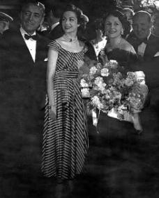 In striking ballet length gown, screen star Margaret Lockwood meets Ronald Colman and his wife, Benita Hume, at the premiere of 'A Double Life' on 20th May, 1948.