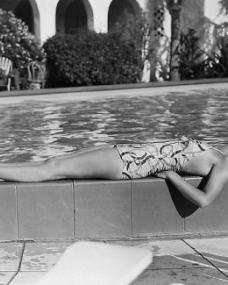 British actress Margaret Lockwood sunbathes by the pool in Hollywood