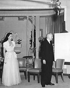 Margaret Lockwood and Harold Huth await the arrival of guests to celebrate the golden jubilee of Nettlefold Studios