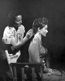 Candid photo of Margaret Lockwood having her hair done in the make-up chair