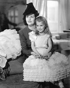 Margaret Lockwood sits daughter Julia Lockwood on her knee
