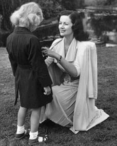 Margaret Lockwood dresses her daughter Julia Lockwood ready for a walk in the park