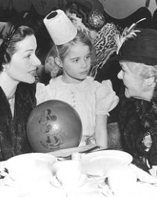 Margaret Lockwood chats to a guest at her daughter Julia Lockwood's birthday party