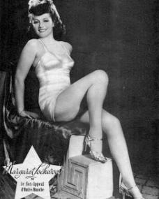 Margaret Lockwood wears a revealing outfit for a 'cheese-cake' publicity photo