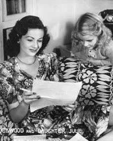 Margaret Lockwood smokes while reading, watched on by her daughter Julia Lockwood