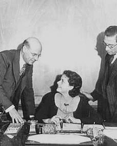 Herbert and Sam Smith, the founders of British Lion Films sign the contract for a young Margaret Lockwood