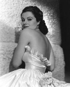 Margaret Lockwood wears a slinky formal dress in a 1930s publicity photo for Paramount Pictures