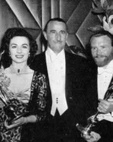 Margaret Lockwood and a bearded John Mills proudly display their Daily Mail Film Award statues