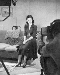 Margaret Lockwood viewed from behind the cameraman during filming at Alexandra Palace