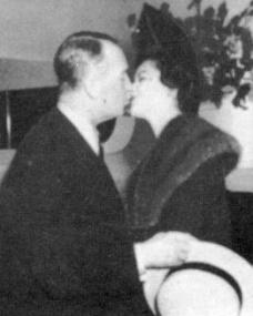 Margaret Lockwood shares a kiss with her former colleague, French film star Maurice Chevalier