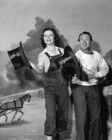 Margaret Lockwood performs with John Mills on stage in a variety show