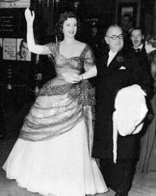 Margaret Lockwood waves to onlooking photographers, accompanied by Herbert Wilcox