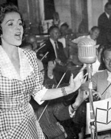 Margaret Lockwood records songs from Laughing Anne.    She was not allowed to sing on the soundtrack.