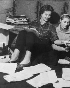 With a record player beside them, Margaret Lockwood and Julia Lockwood go over scripts while relaxing at home