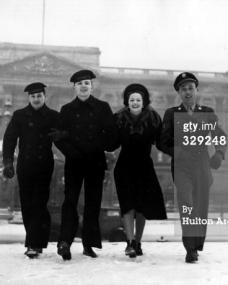 Margaret Lockwood, the British film star and actress, seen outside Buckingham Palace with three American Servicemen who are ardent fans of Britain's number one female star (31st December, 1942).  Photo by Hulton Archive/Getty Images