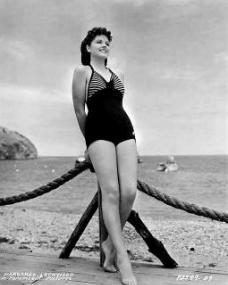 Margaret Lockwood models swimwear on a beach in a 1930s publicity photo for Paramount Pictures