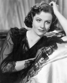 Margaret Lockwood wears a lacy dress
