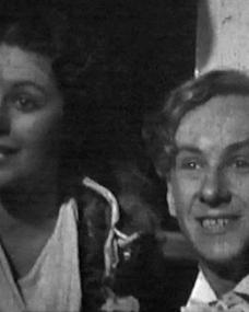 Margaret Lockwood (as Margaret Williams) and Hughie Green (as Hughie Hawkins) in a screenshot from Melody and Romance (1937) (1)