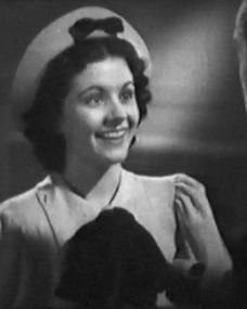 Margaret Lockwood (as Margaret Williams) and Hughie Green (as Hughie Hawkins) in a screenshot from Melody and Romance (1937) (3)