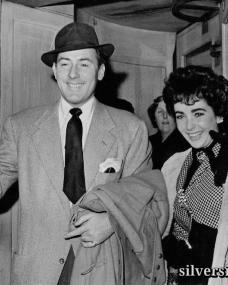 Screen actor Michael Wilding, aged 39, with his actress-bride Elizabeth Taylor, aged 19, leave their London hotel for London Airport.  They are flying to Paris for their honeymoon following their marriage yesterday (Thursday) at Caxton Hall, London.  22nd February, 1952.