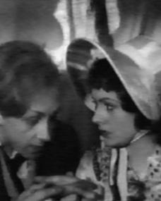 Hughie Green (as Midshipman Easy) and Margaret Lockwood (as Donna Agnes) in a screenshot from Midshipman Easy (1935) (1)