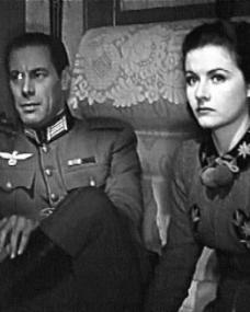 Rex Harrison (as Gus Bennett) and Margaret Lockwood (as Anna Bomasch) in a screenshot from Night Train to Munich (1940) (3)