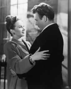 Joan Greenwood (as Jenny Carden) and John Mills (as Jim Ackland) in a photograph from The October Man (1947) (4)