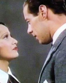 Merle Oberon (as Jane Benson) and Rex Harrison (as Dr Freddie Jarvis) in a colour photograph from Over the Moon (1939)