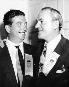 Sid Field laughs with American actor Pat O'Brien while at the Masquers Club, Hollywood