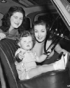Patricia Roc hands over the driving to a small child