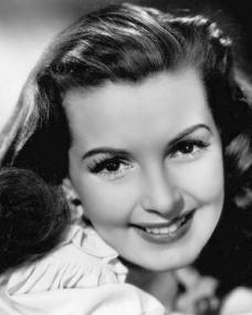 Patricia Roc with long hair smiles for the camera
