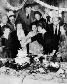 Cutting the cake at the Pinewood Studios' Christmas party in 1949 are Margaret Lockwood, Jean Simmons and Jean Kent. Also pictured are Dirk Bogarde, Petula Clark, Anouk Aimée, Jimmy Hanley and Kathleen Ryan.