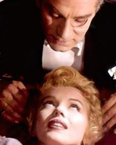 Elsie (Marilyn Monroe) looks up at the Regent (Laurence Olivier) in The Prince and the Showgirl