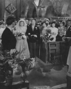 Margaret Lockwood and A E Matthews walk up the aisle as Derek Farr looks on in a photograph from Quiet Wedding
