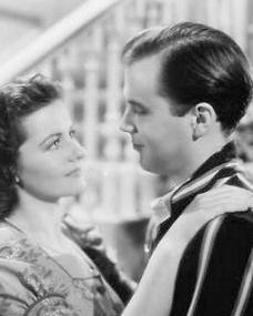 Margaret Lockwood (as Janet Royd) and Derek Farr (as Dallas Chaytor) in a photograph from Quiet Wedding (1941) (5)