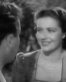 Derek Farr (as Dallas Chaytor) and Margaret Lockwood (as Janet Royd) in a screenshot from Quiet Wedding (1941) (2)