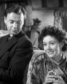 Derek Farr (as Denys Royd) and Barbara White (as Miranda Bute) in a screenshot from Quiet Weekend (1946) (1)