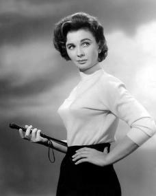 Jean Simmons strikes a pose as she holds in her hand a riding crop