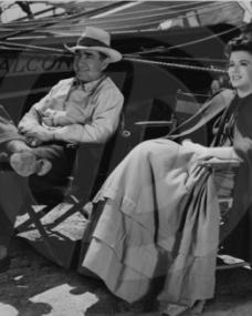 Frank Lloyd, director, and Margaret Lockwood relax in their chairs during filming of Rulers of the Sea