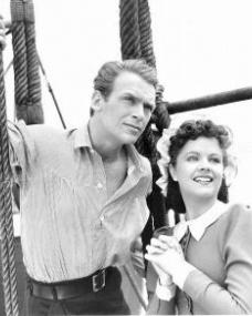 Douglas Fairbanks Jr (as David 'Davie' Gillespie) and Margaret Lockwood (as Mary Shaw) in a photograph from Rulers of the Sea (1939) (18)