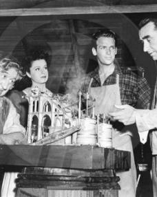 Will Fyffe, Margaret Lockwood and Douglas Fairbanks Jnr. look on as director Frank Lloyd shows off a model from Rulers of the Sea