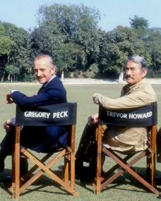 Behind the scenes photo from the 1980 film, The Sea Wolves, featuring Trevor Howard, David Niven, Gregory Peck and Roger Moore.  The actors are sitting in each other's named chairs