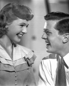 Jack Read (Richard Attenborough) and Lynne Hartley (Sheila Sim) laugh uproariously in The Guinea Pig (1948)