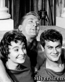 Jean Simmons, Kirk Douglas and Tony Curtis laugh happily in a candid shot taken during a break from filming on the set of Spartacus
