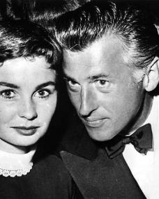 A candid shot of Jean Simmons and Stewart Granger in formal wear