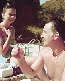 Stewart Granger smokes while in swimming costume with Jean Simmons